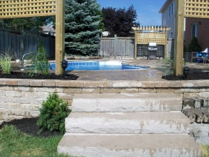Stairs leading to pool area by BP Landscape and Durham Poolscapes
