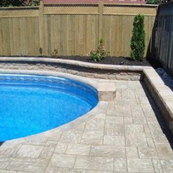 inground pool and garden wall