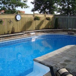 Inground pool with interlock deck and garden wall