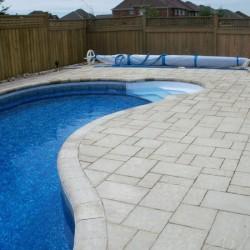 beautiful pool hardscaping