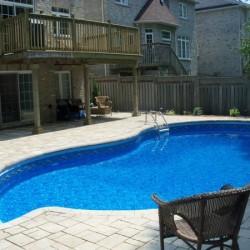 inground pool with interlock type pool deck
