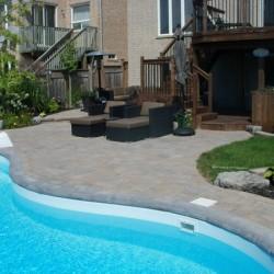 beautiful pool deck area landscaped